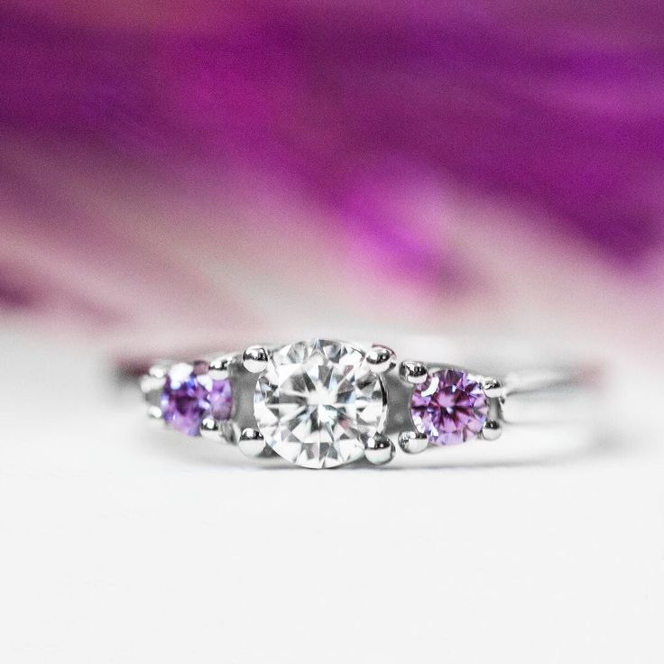 Birthstone accents add the perfect touch to any piece of jewelry.  Click the link in our bio to create your own masterpiece! . . . #jewelry #fashion #accessories #style #amethyst #purple #diamond #ring #engagementring #promisering #sparkle #inlove #love #cute #swarovski #gold #silver