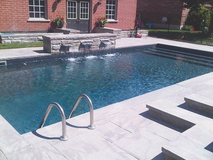 Installed By Megna Pool In Toronto, This Classic, Rectangle Shaped Swimming  Pool Features
