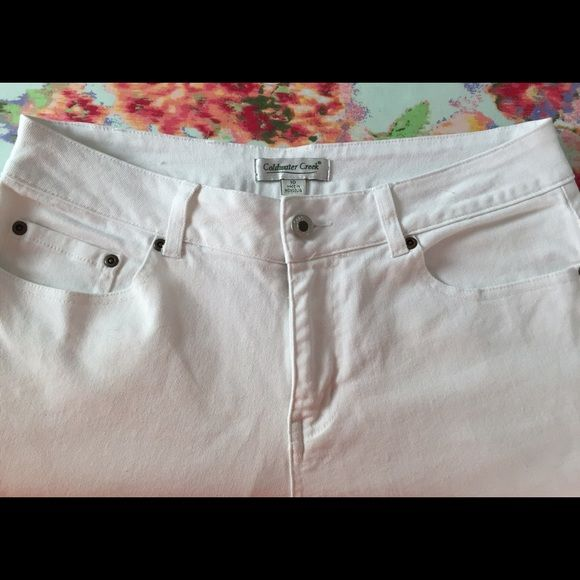 Coldwater Creek White Bootcut Jeans Pants Size 10 Coldwater Creek White Bootcut Jeans Pants Size 10, has some discoloration/wear on bottoms from walking (please see last picture). Rest of pant is in good pre-owned condition. Maybe could be bleached? Still a nice pair of white jeans. Coldwater Creek Jeans Boot Cut