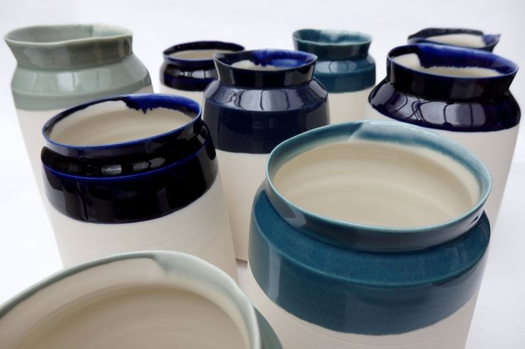 porcelain bottle forms with uneven edges; handmade and crafted in London, UK