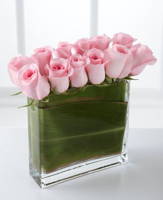 Interesting rose arrangement.    http://www.albuquerqueflorist.com/product/the-ftd-eloquent-pink-rose-bouquet/display