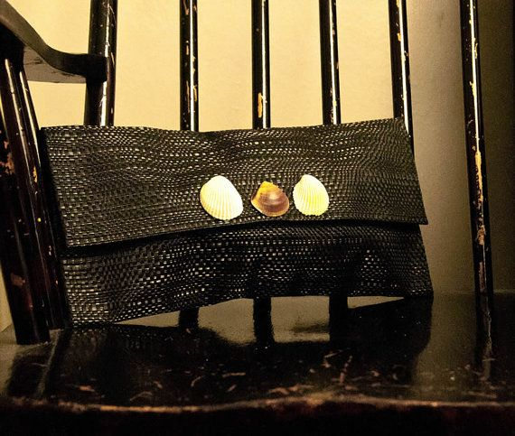 Clutch purse by RufinaD on Etsy, £24.00  This is a sleek and versatile clutch bag embellished with beautiful seashells.