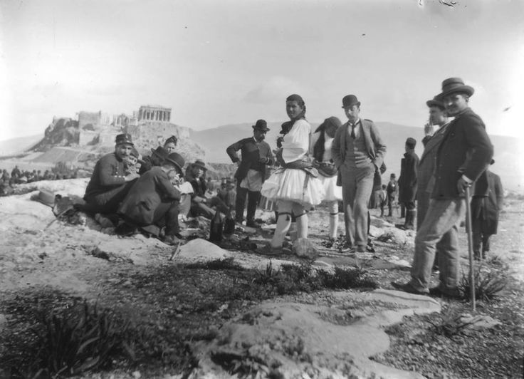 Gathering of people, Athenian Acropolis in the background Γιορτάζοντας τα Κούλουμα.This photograph was taken by Nicholson Museum curator William J Woodhouse in Greece between 1890 and 1935. https://www.flickr.com/