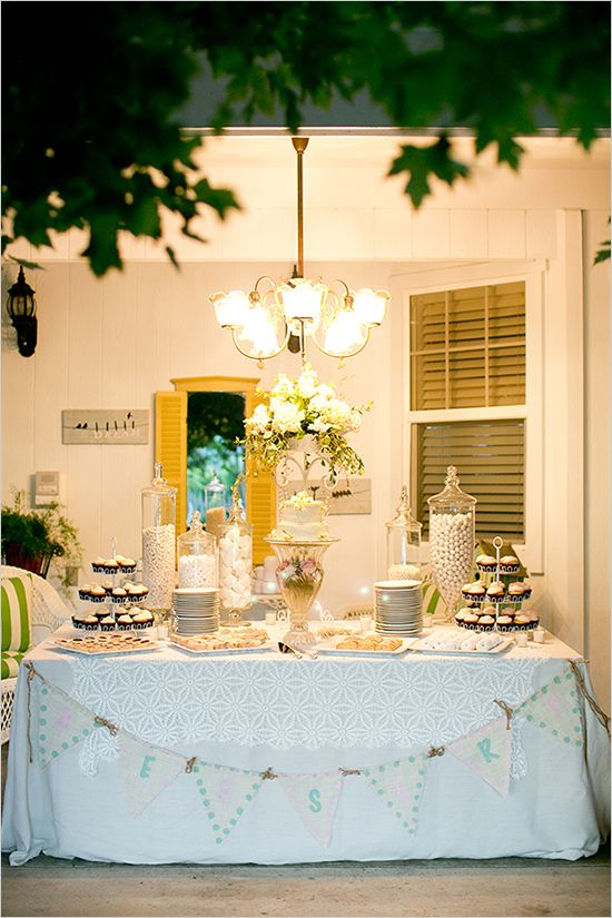 elegant dessert table...actually, what I'm noticing most is the little painting/art piece hanging on the wall in the back