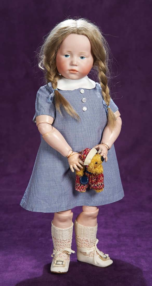 """Marks: K*R 101 49. Comments: Kammer and Reinhardt,circa 1909,""""Marie"""" from the firm's art character doll series. Value Points: exceptional quality of sculpting on the desirable model,with very beautifully-painted features,original wig,body and body finish,nice antique costume"""