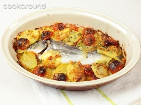 Orata al forno con patate e pomodorini ciliegia