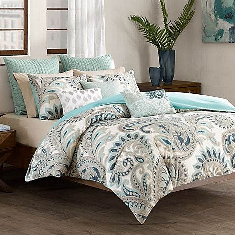 Transform your bedroom into a cool, contemporary retreat with the INK+IVY Mira Comforter Set. Adorned with a paisley design in shades of blue and taupe, the unique bedding is a lively addition to any room's décor.