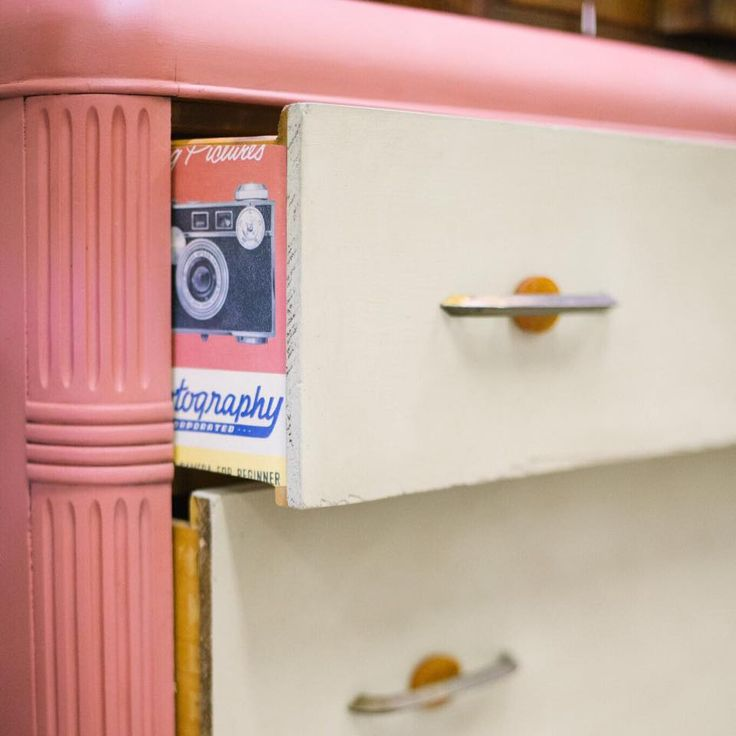 This Art Deco Dresser was given a makeover with Chalk Paint® decorative paint by Annie Sloan in Scandinavian Pink and Versailles. The sides of the drawers were finished using Annie Sloan Decoupage Medium and a fun decorative paper | By Boho Upcycle
