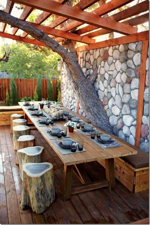 Wood seating with stone wall.