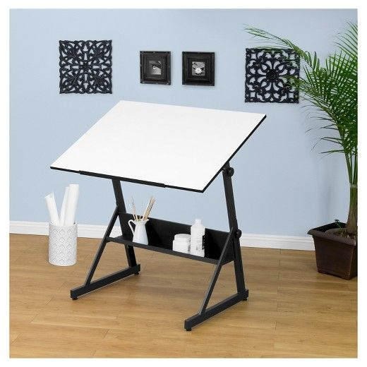 """The Studio Designs Solano Adjustable Tilt Table brightens your work area so your creativity can flourish. Don't be fooled by it's simple design. It's triangular shape keeps it rock steady, and four floor levelers help if your floors are less than perfect. These beautiful tables feature easy height adjustment, and a tilt angle that goes from flat, to a near perfect vertical (80 degrees!). All this plus a convenient shelf for your """"go to"""" supplies. Main work surface: 41...."""