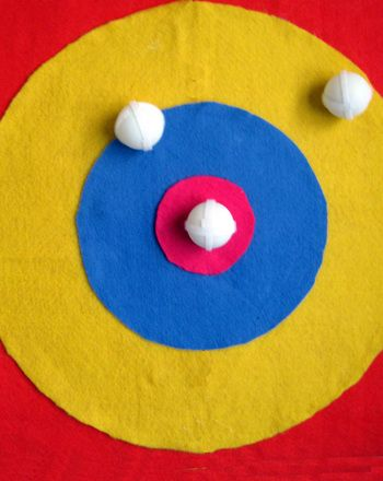 Your child will boost her gross motor skills as she has fun playing with your easy-to-make and totally safe dart board and dart balls.