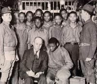 The Scottsboro Boys with their lawyer and guards (UPI photo, March, 1933).