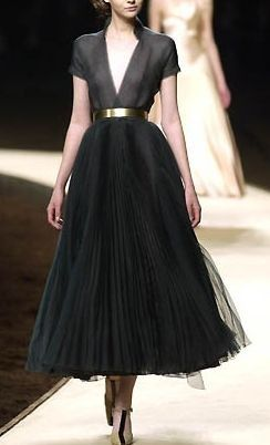 A gorgeous black Chanel dress. Usually not a fan of this length dress but wow.