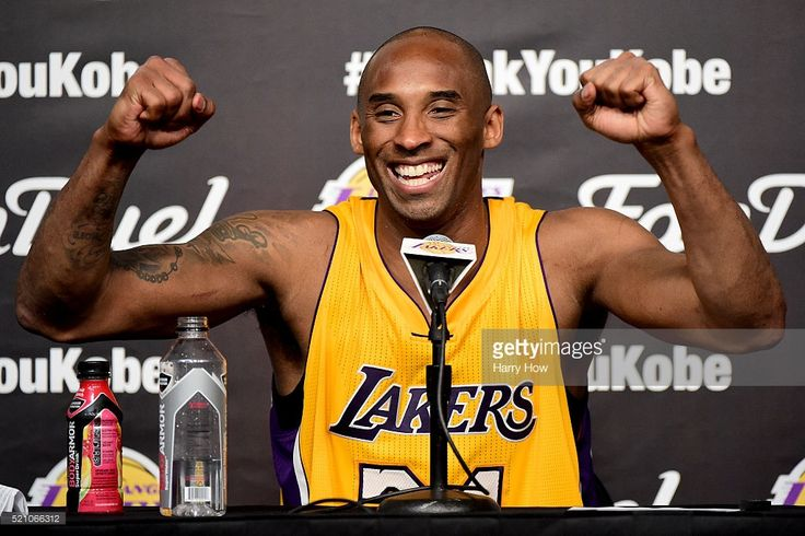 Kobe Bryant #24 of the Los Angeles Lakers smiles during the post game news…