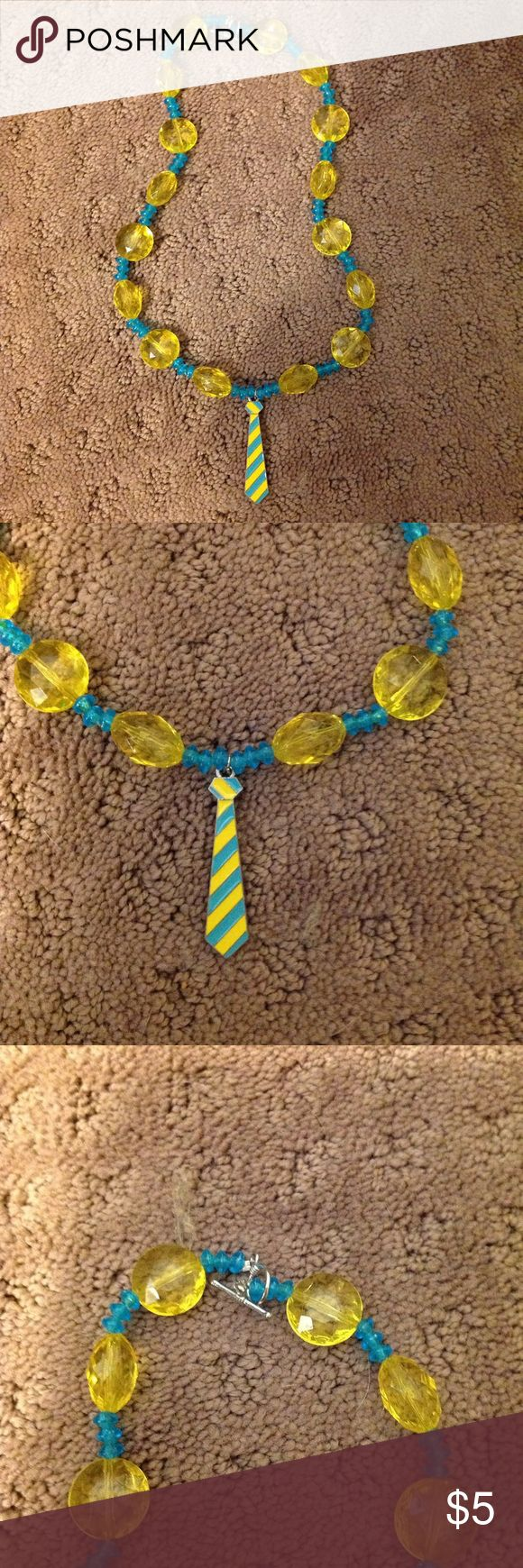 Novelty Tie Beaded Necklace Novelty blue and yellow beaded necklace with tie charm. Etsy Jewelry Necklaces