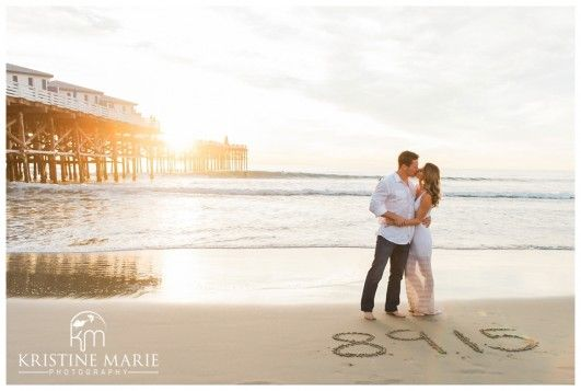 Wedding Date Written on the Sand   Crystal Pier Beach Engagement Photo   San…