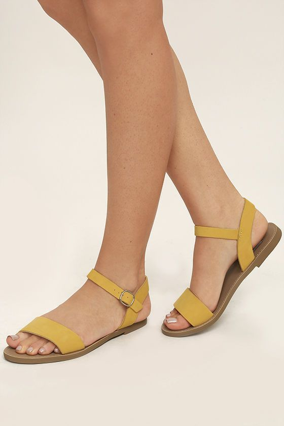Jet-setting to Cancun or the Bahamas? Then make your travel partner the Steve Madden Donddi Yellow Nubuck Leather Flat Sandals! A genuine leather toe band pairs with an adjustable quarter strap (with silver buckle).