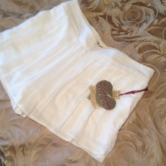 White chiffon pleated skort Soft and sweet, feminine & flirty skort with pockets! Can be worn with dressy tops for a fantastic dressy causual outfit, or as a tennis skirt, or add a crop top and chuck Taylor/ converse or coach sneakers for an edgier or sportier look! I have a size small & a size extra large, will trade for a medium or large! vera wang princess  Shorts Skorts