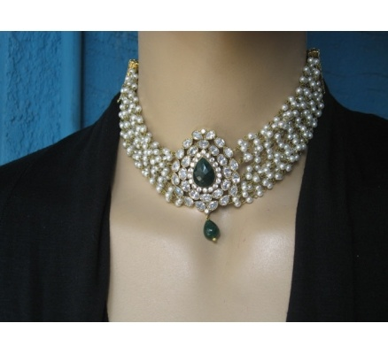 A kundan pendant choker with pearl trails around it. Perfect with Indian outfits