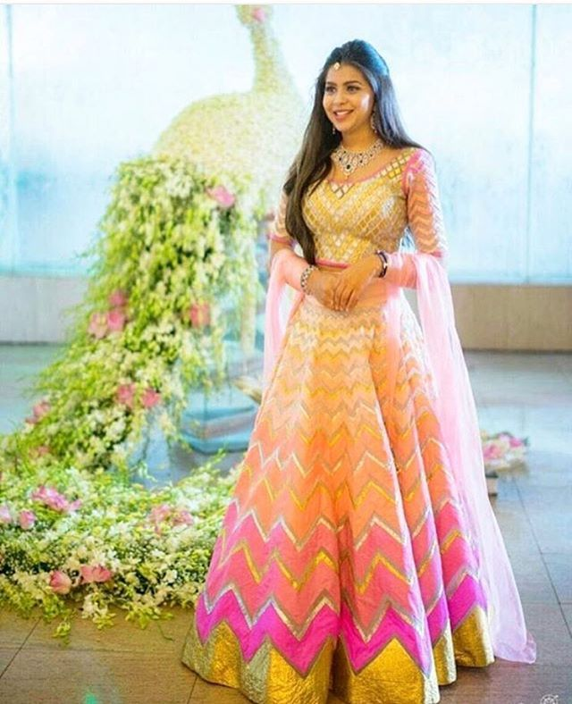 Candy colors and stripes = love .  See more lehenga inspiration on the WedMeGood app | outfit by @abujanisandeepkhosla |  #lehenga #candy #indianbride #wedding #bride #brides #weddingday #mehendi #ombre #shades #blouse #gold #pink #stripes #brides #weddings #sisterofthebride #fashion #indianfashion #indianwear #love