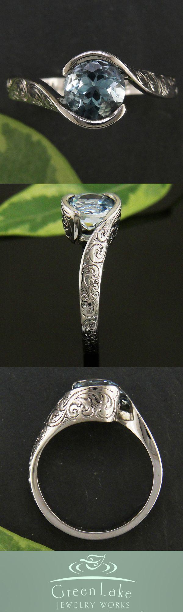 With a diamond instead. Custom palladium wrap mounting for stunning Aquamarine.