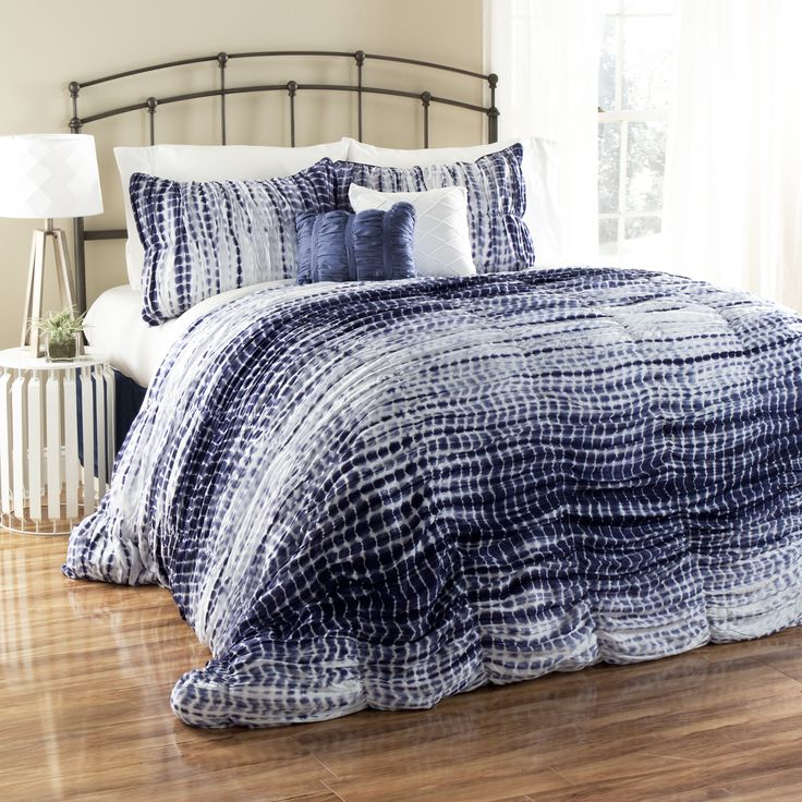 Crafted of microfiber, this beautiful comforter set is designed to last. The blue and navy tie dye pattern completest the look.