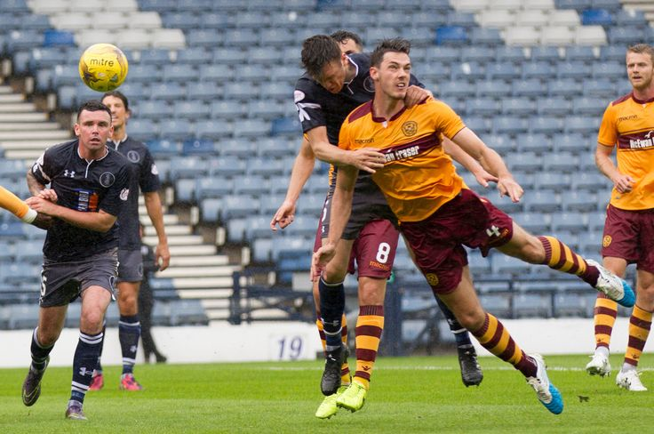 Queen's Park's Adam Cummins heads for goal during the Betfred Cup game between Queen's Park and Motherwell