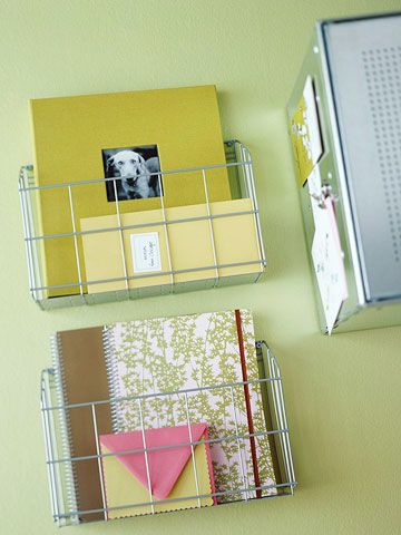 Repurpose metal racks made to fit in kitchen cabinets! Here they become wall-mounted notebook holders. How-to: http://www.bhg.com/rooms/home-office/accessories/home-office-solutions/#page=15