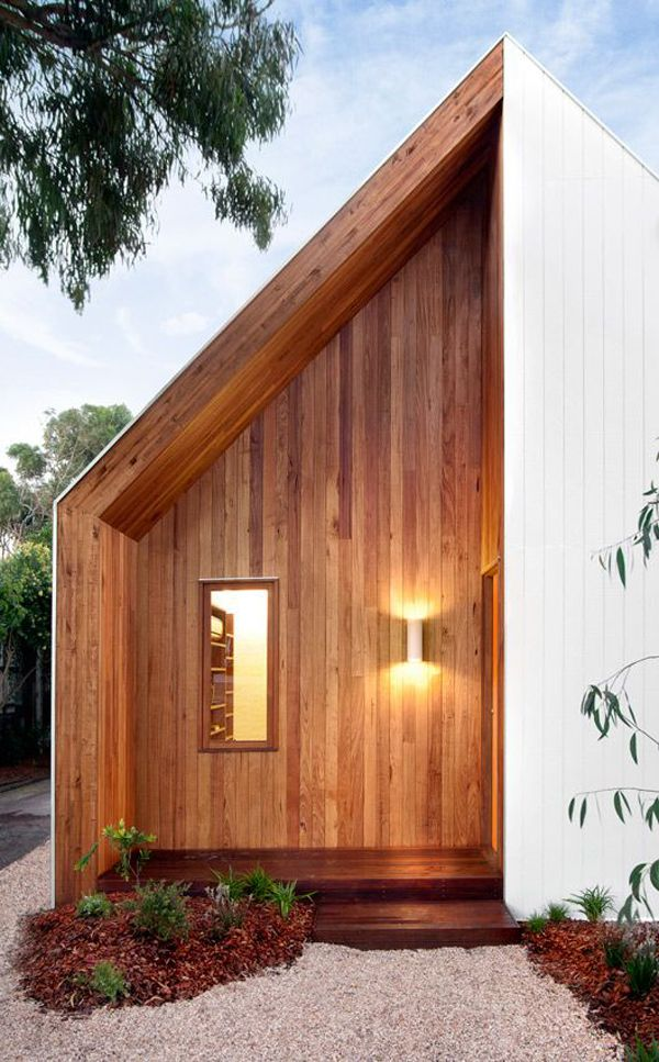 MAKING AN ENTRANCE: Auhaus Architecture used warm wood cladding to mark the entrance to this sweet Australian beach house.