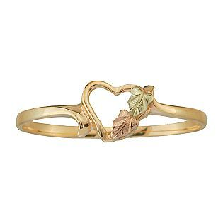 This is almost like mine! Mine has two hearts and a diamond-looking stone. :)