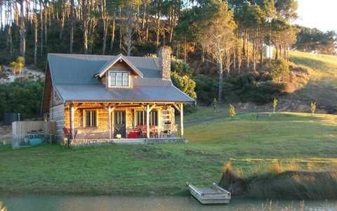 I'm not a fan of pre-fabs; but, if I were to lower my standards (from cob), this would make me smile.  The Silver Mountain from Appalachian Log Homes is a classic small log cabin design. At one and a half stories, it encompasses a total of 707 square feet.