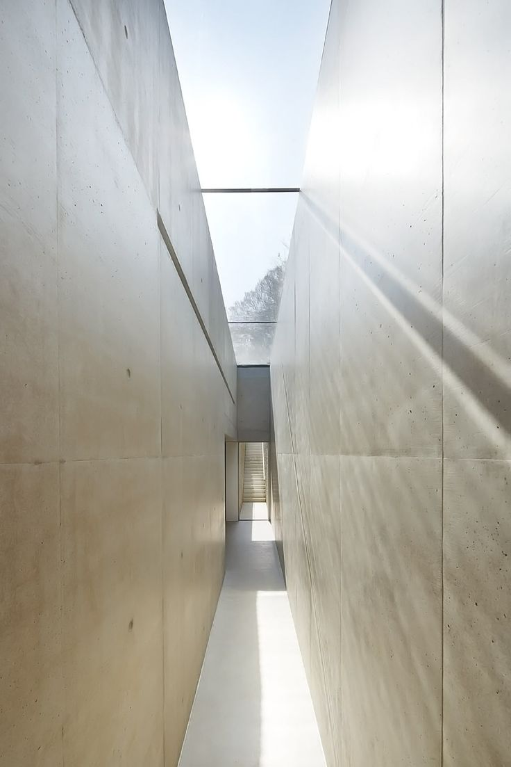 Top-lit concrete corridor by Found Associates. Photo by Hufton + Crow.