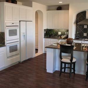Trafficmaster allure 6 in x 36 in dark walnut luxury for Allure kitchen cabinets