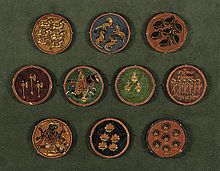 (2) The name Ganjifa comes from the Persian word ganjifeh (گنجفه), meaning playing card. The first known reference is in an early-16th century biography of Bâbur, the founder of the Mughal dynasty. The game first became popular at court, in the form of lavish sets of precious stone-inlaid ivory or tortoise shell (darbar kalam). It later spread to the general public, whereupon cheaper sets (bazâr kalam) would be made from materials such as wood, palm leaf, or pasteboard.