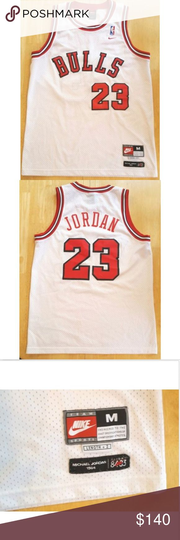 """Auth MICHAEL JORDAN BULLS Rookie Stitched Jersey 100% authentic Nike Chicago Bulls NBA Michael Jordan rookie jersey! Men's size medium, length +2. Stitched! """"BULLS 23"""" stitched on front, and """"JORDAN 23"""" stitched on back. Good pre-owned condition, see pictures. Nike Shirts Tank Tops"""