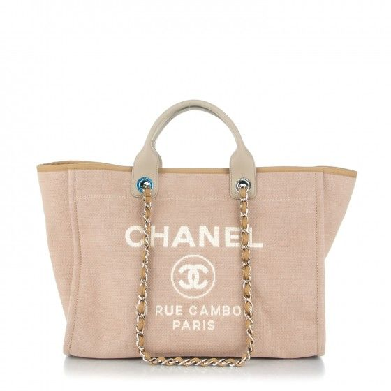 81d61c730 This is an authentic CHANEL Canvas Large Deauville Tote Ecru. This stylish  tote is crafted of fine canvas in light beige with a white printed Chanel  Rue ...