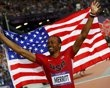Aries Merritt of the U.S. celebrates after winning the men's 110m hurdles final during the London 2012 Olympics Games