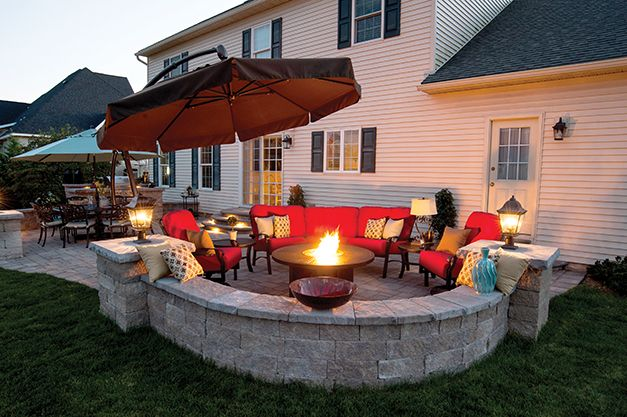 Family entertainment area, including stone seating and fire pit, created by Inchs Landscaping.
