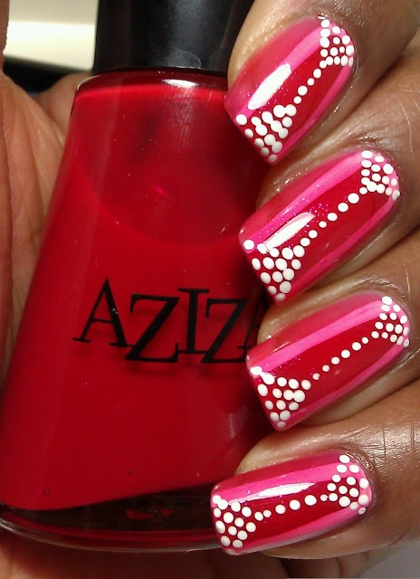 from MUA...laquerlove...Aziza red jelly, Aziza red shimmer with dots 1. Painted Thick stripe with the jelly red in middle of each nail 2. Painted thinner stripes around the red in white acrylic paint 3. Painted red shimmer over the whole nail 4. Added dots with the dotting tool