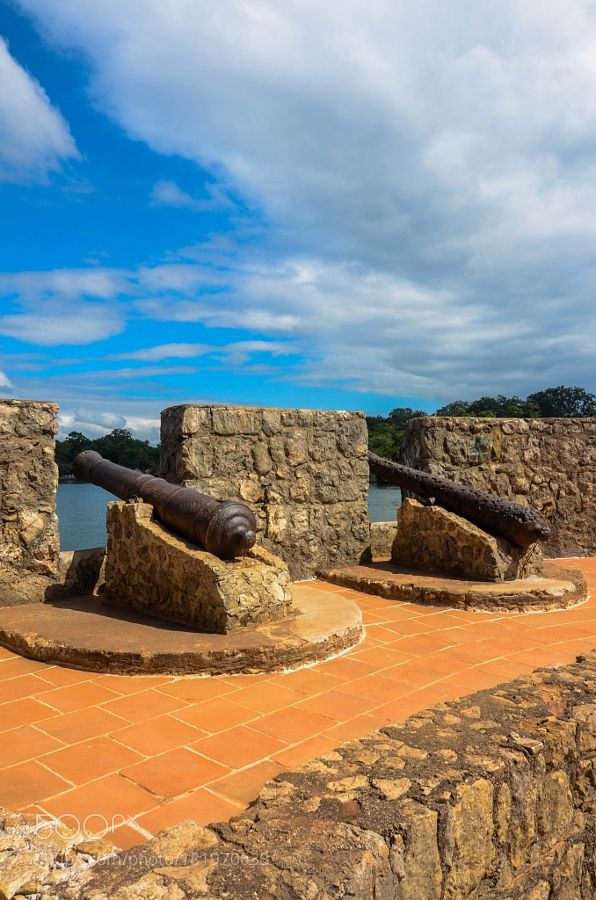 http://500px.com/photo/181970633 Twin Canons by chriswtaylor -Puerto Barrios Guatemala.. Tags: skylakewatercloudshistorywarstonefortressforthistoricbattlecanonsGuatemalaCentral AmericaPuerto BarriosRio Dulce