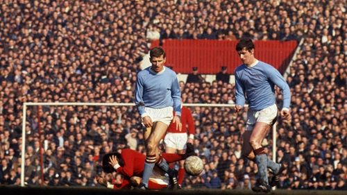 Tony Book (left) and Mike Doyle in action against Man Utd.