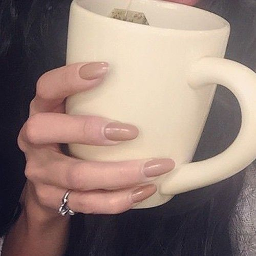 Vanessa Hudgens had long round nails painted with glossy brown color