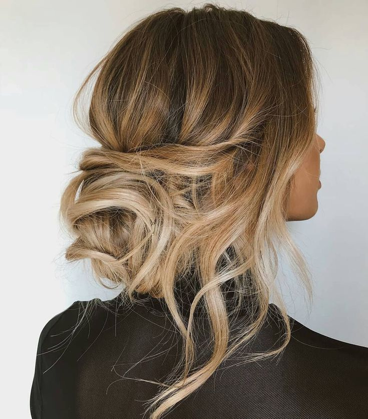 Blowdry hair smooth and upside down w/ round brush. Curl hair w/ large curling iron. Tease crown and smooth over top. Leave out face framing pieces, Pull everything into a low chignon. Grab a left out section and wrap around elastic. Pij in place. Hairspray.