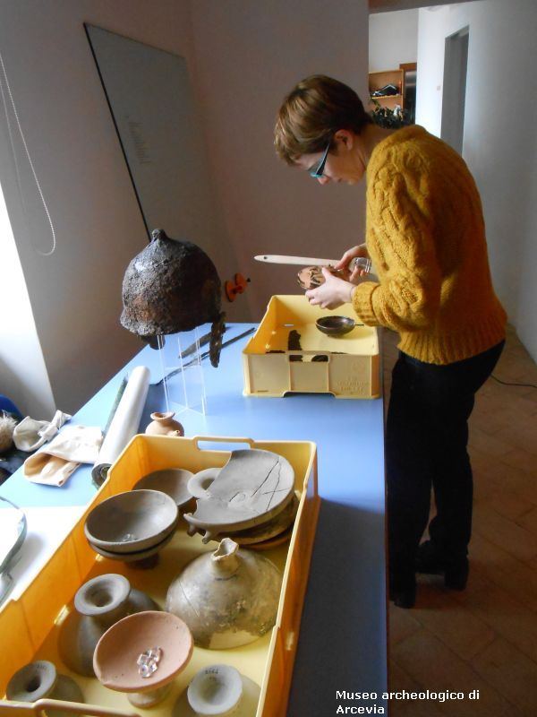 The cleaning of exhibits and showcases of Montefortino necropolis - Arcevia - Marche - Italy