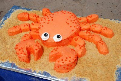 Crab cake: center is single (thick) layer circle, carved into an oval. Claws are two circles cut from another single layer. Legs are Twinkies cut in half.