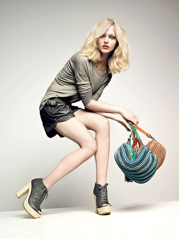 Sasha Pivovarova gets expressive for the spring 2011 campaign from Santa Lolla. Love the angled pose. Fashion photography