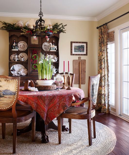 Dining room table with paisley shawl -- The Polohouse -- photo by Werner Straube for Midwest Living