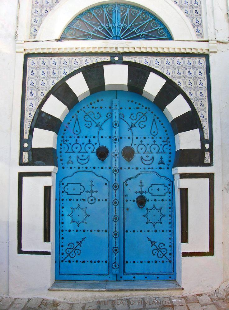 Beautiful blue door by Virpi Alaiso