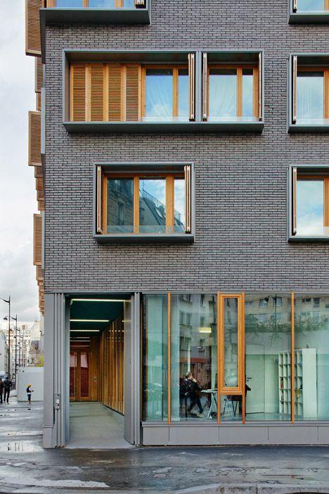 Michel Guthmann pairs grey brick with larch for Paris housing block