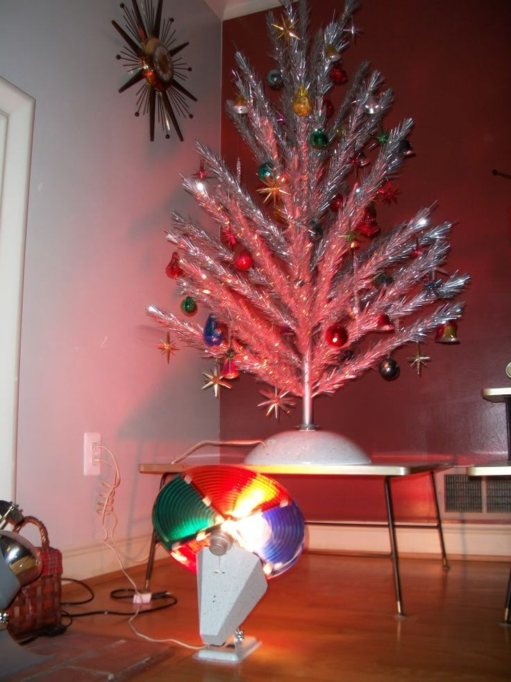 an aluminum Christmas tree illuminated by a revolving color wheel